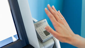Woman hand using palm ID at first alliance credit union