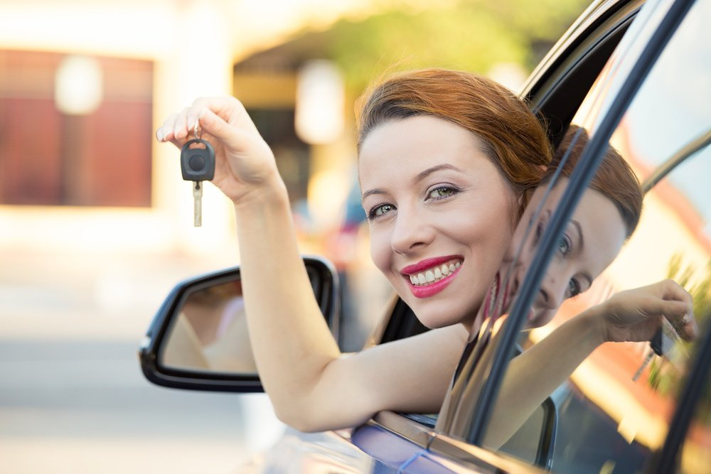 Woman showing off auto keys | First Alliance Credit Union
