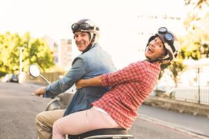 Couple on Scooter | First Alliance Credit Union