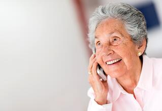 Happy woman on phone | First Alliance Credit Union