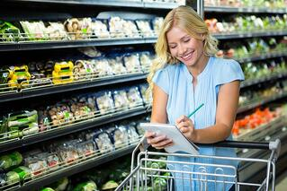 Woman checking grocery list | First Alliance Credit Union