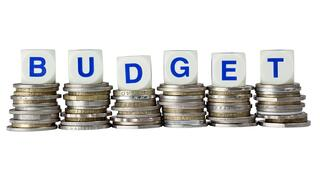 The word budget stacked on coins