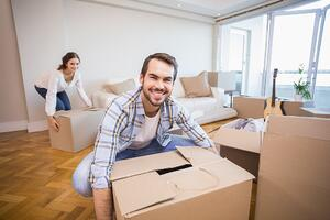 Couple decluttering | First Alliance Credit Union