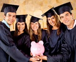 Graduate students holding a piggybank with education savings | First Alliance Credit Union