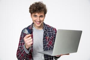 Man with laptop | First Alliance Credit Union