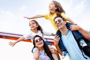 Happy family enjoying themselves on a vacation   First Alliance Credit Union