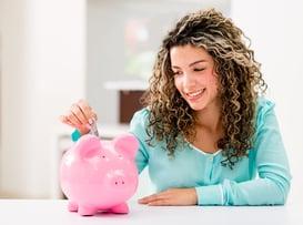 Woman saving money   First Alliance Credit Union