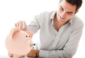Man with a piggybank looking for his savings - isolated over a white background