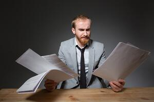 Man reading papers   First Alliance Credit Union