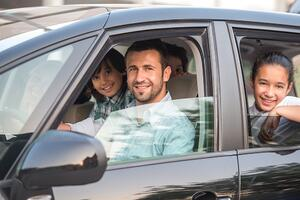Family in car | First Alliance Credit Union