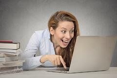 Overly excited woman on computer