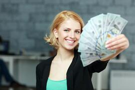 woman with money | First Alliance Credit Union