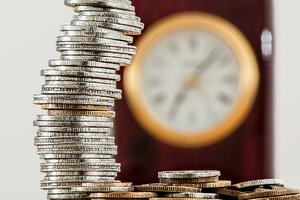 Coins and clock | First Alliance Credit Union