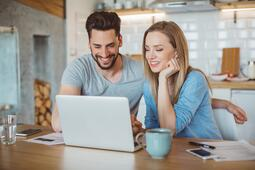 Couple on laptop | First Alliance Credit Union