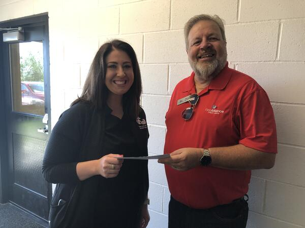 Paws and Claws accepts donation check from First Alliance Credit Union