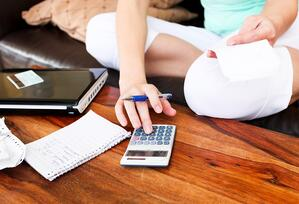 Woman Calculating Payment | First Alliance Credit Union