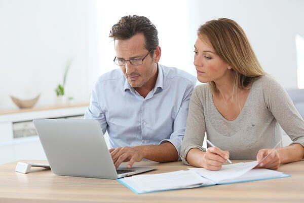 Couple at home using online banking