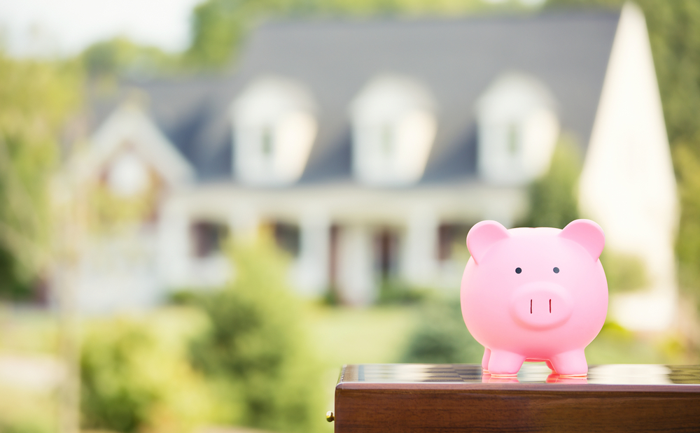 Piggy bank in front of a house