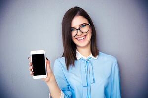 Woman and smartphone | First Alliance Credit Union