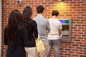 People lined up at ATM