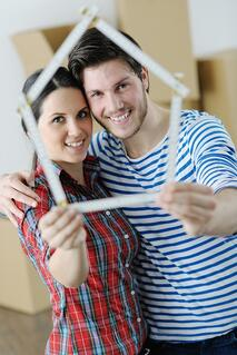 Couple looking at ruler | First Alliance Credit Union
