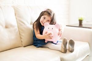 Child holding piggy bank | First Alliance Credit Union