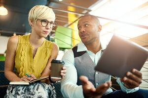 Couple talking finances | First Alliance Credit Union