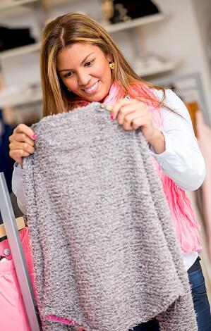 Happy woman shopping   First Alliance Credit Union