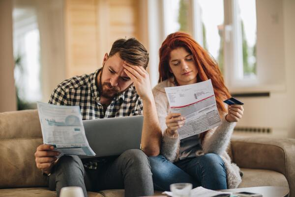 Couple reading loan information | First Alliance Credit Union