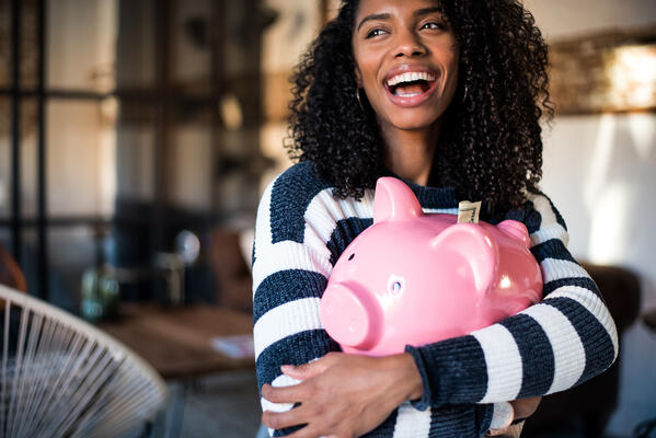 Woman experiencing positive effects of saving money | first alliance credit union