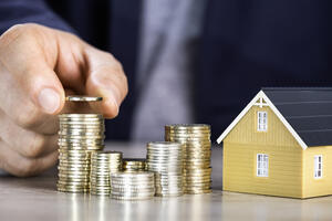 Coins and model home | First Alliance Credit Union