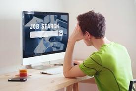 Man job hunting | First Alliance Credit Union