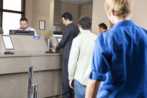 People standing in line at a credit union | First Alliance Credit Union